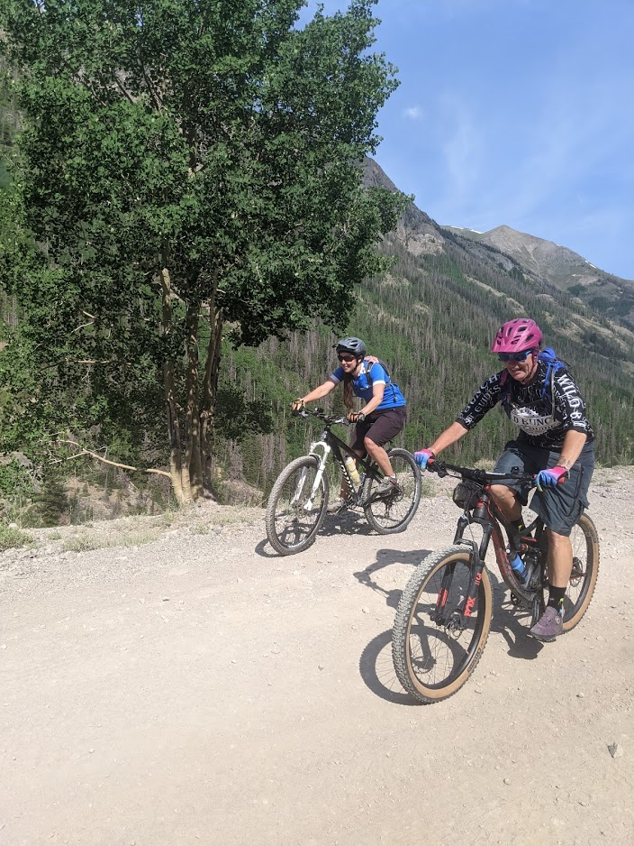 Laurel Darren (right) enjoys the trails of Colorado's San Juan Mountain on a mountain bike ride with Lake City local Lydia McNeese. The two are training with another Lake City resident, Amanda Hartman, for a race there next month during Darren's summer vacation away from day-to-day operations for Arizona's Wild Bunch Desert Guides.