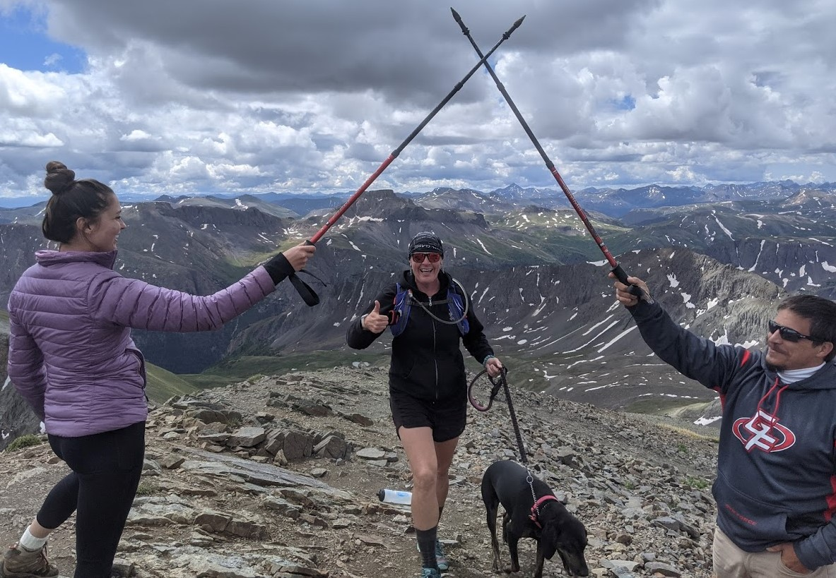 With hiking poles hoisted to the heavens, Laurel Darren (center), owner of Arizona's Wild Bunch Desert Guides, is