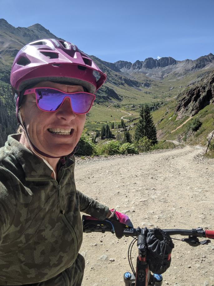 Laurel Darren -- owner of Wild Bunch Desert Guides, a highly-rated Phoenix adventure tours company -- pauses to share a big smile during a mountain bike ride in the Lake City region of Colorado's scenic San Juan Mountains. Darren spent the summer again in Lake City and the work break