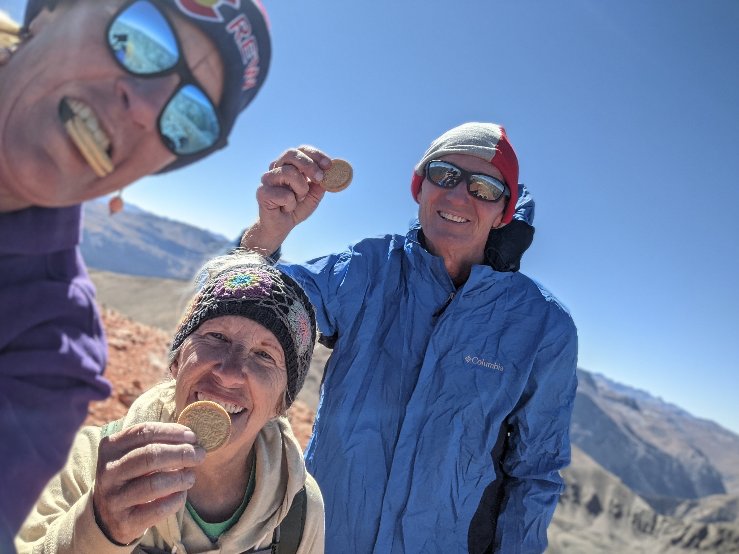 Laurel Darren (left), owner of the Wild Bunch Desert Guides, enjoys some Golden Oreos with Caron Jones (center) and Glenn Heumann (right) of the Lake City Hiking Club. The trio were celebrating reaching the summit of the 14,000-foot Redcloud peak during a hike in late Sept. 2021.