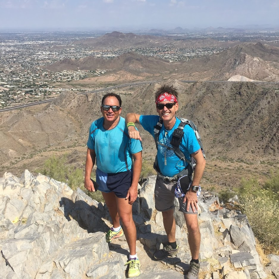 A guide and a guest share a breathtaking view during one of our Phoenix hiking tours. The Wild Bunch Desert Guides want to enjoy showing our guests a good time. However, the guides also are medically trained to handle any emergency while on an adventure.