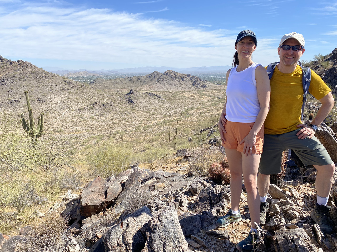 A couple enjoy the beautiful desert scenery during one of this summer's Phoenix hiking tours from the Wild Bunch Desert Guides.