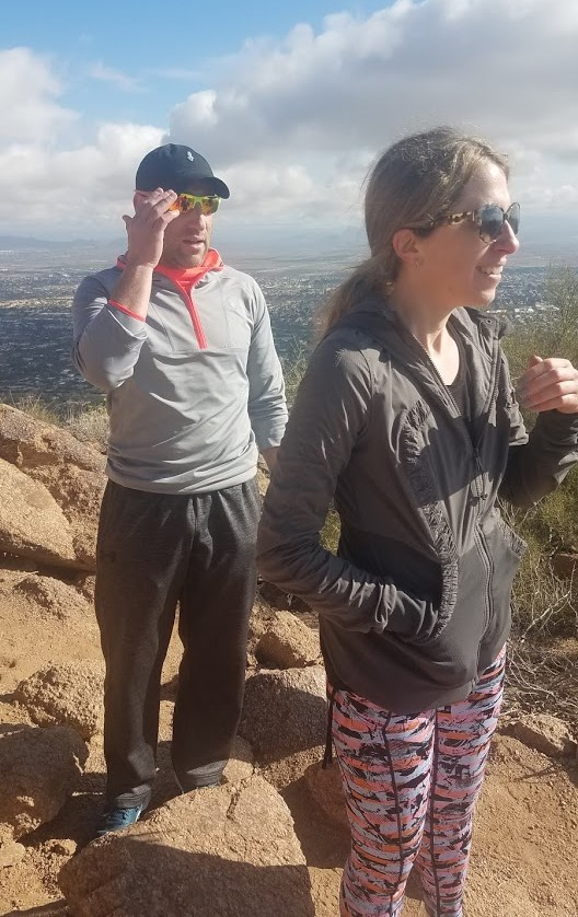 An interested man (left) and smiling woman (right) enjoy the unbelievably beautiful scenery of Arizona's Sonoran Desert during a recent Wild Bunch Desert Guides hike.
