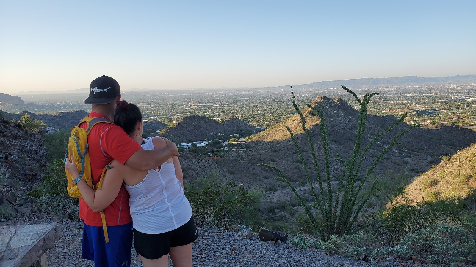A couple embrace while taking in another beautiful view together during one of the Scottsdale hiking tours with Wild Bunch Desert Guides.