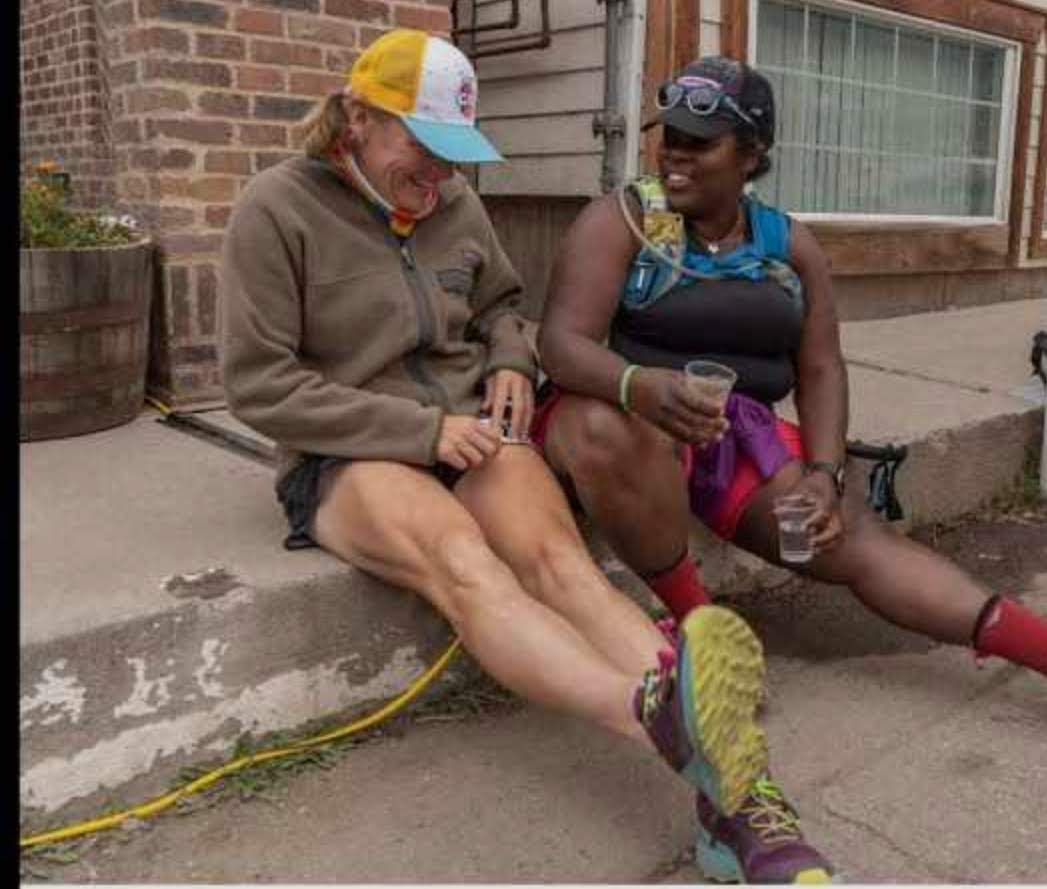 Laurel Darren (left) and The Mirnavator sit on some steps to laugh about their latest adventure together.