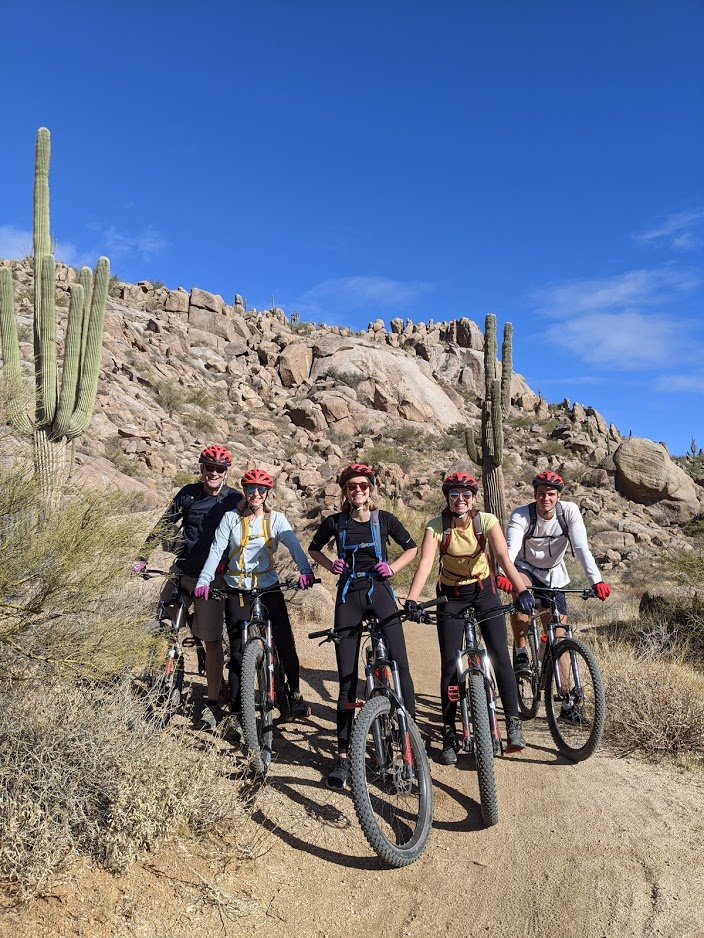 A group of mountain bike riders pause to enjoy the beautiful surroundings during a Wild Bunch tour.
