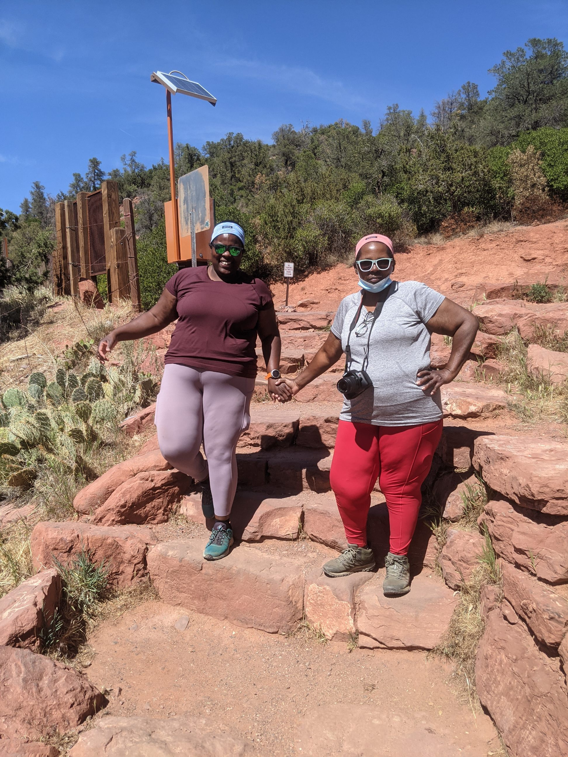 Mirna Valerio (left) and her mother JoAnn enjoy a moment together while holding hands on the Red Rocks of Sedona, Ariz.