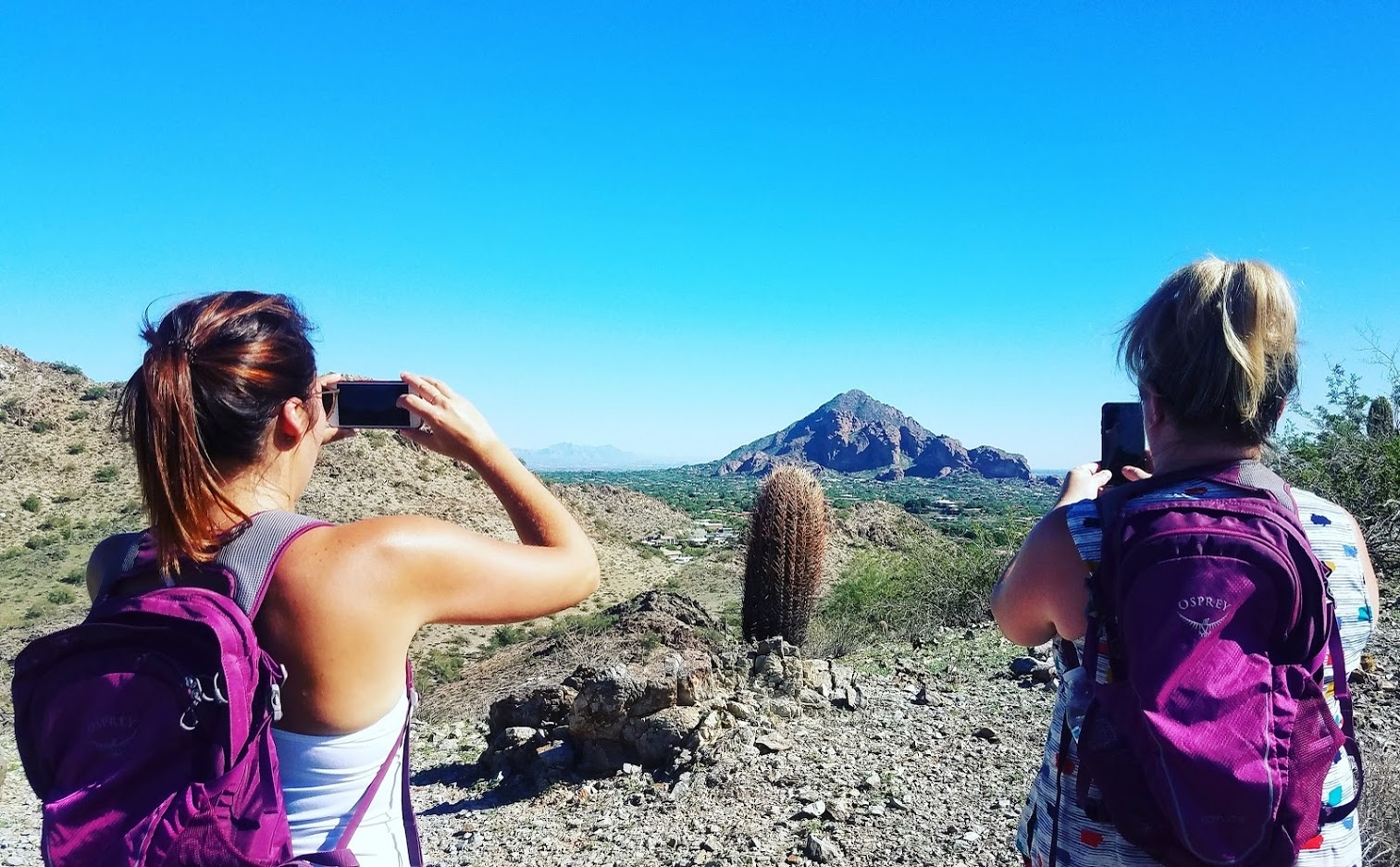 Two women take pictures of the breath-taking landscapes in Arizona's Sonoran Desert.