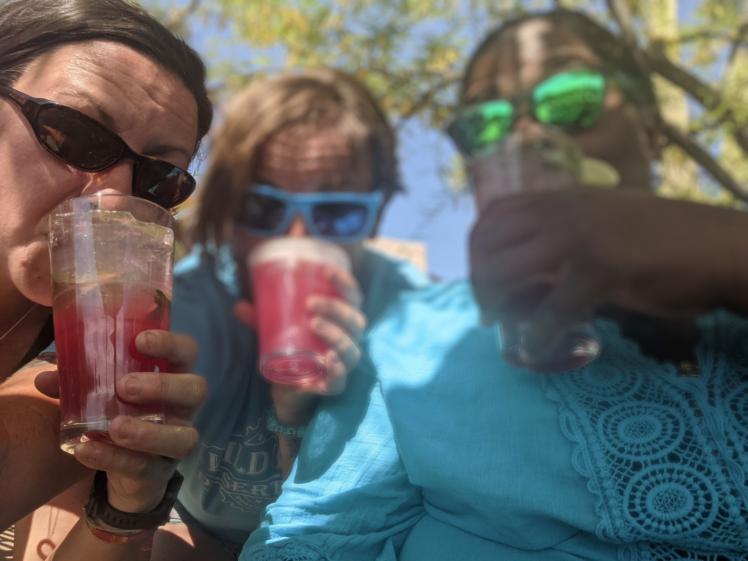 Michelle Craig (left), Laurel Darren (center) and Mirna Valerio enjoy either a Prickly Pear Margarita or Mojito during one of their all-girl talk sessions after another day of mountain biking.