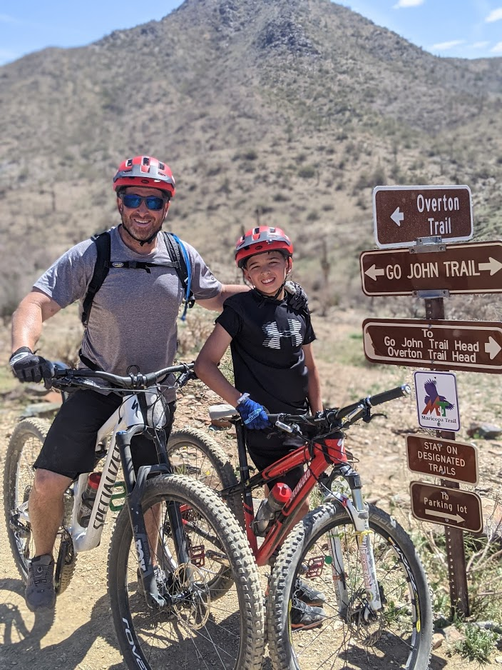 Bless our Memorial Day heroes for making possible guided Scottsdale mountain biking, where a smiling father and son duo (pictured) can enjoy some quality time together in breathtaking surroundings.