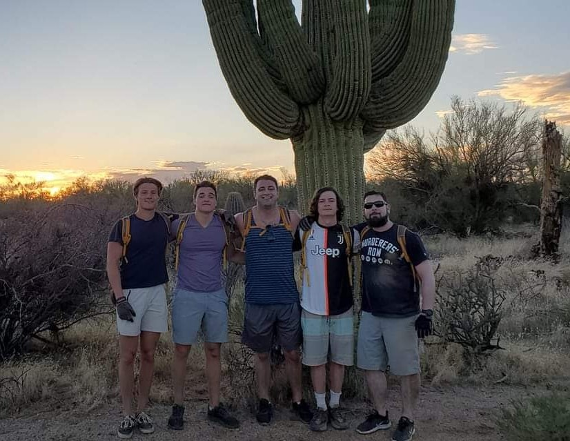 The heroes we celebrate on Memorial Day made it possible for Americans to enjoy activities such as Phoenix hiking and beautiful sites including an Arizona sunset. (Pictured) A group of five friends enjoy both items during one of the Phoenix adventure tours with the Wild Bunch Desert Guides.